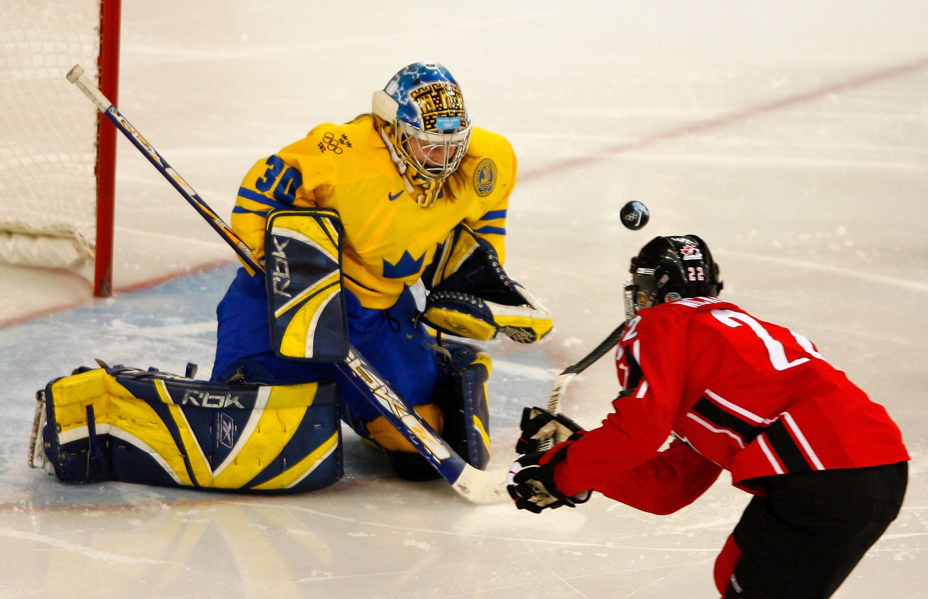 Hayley Wickenheiser #22 of Canada takes a shot on goal in front of goalie Kim Martin #30 of Sweden during the final of the women's ice hockey during Day 10 of the Turin 2006 Winter Olympic Games.