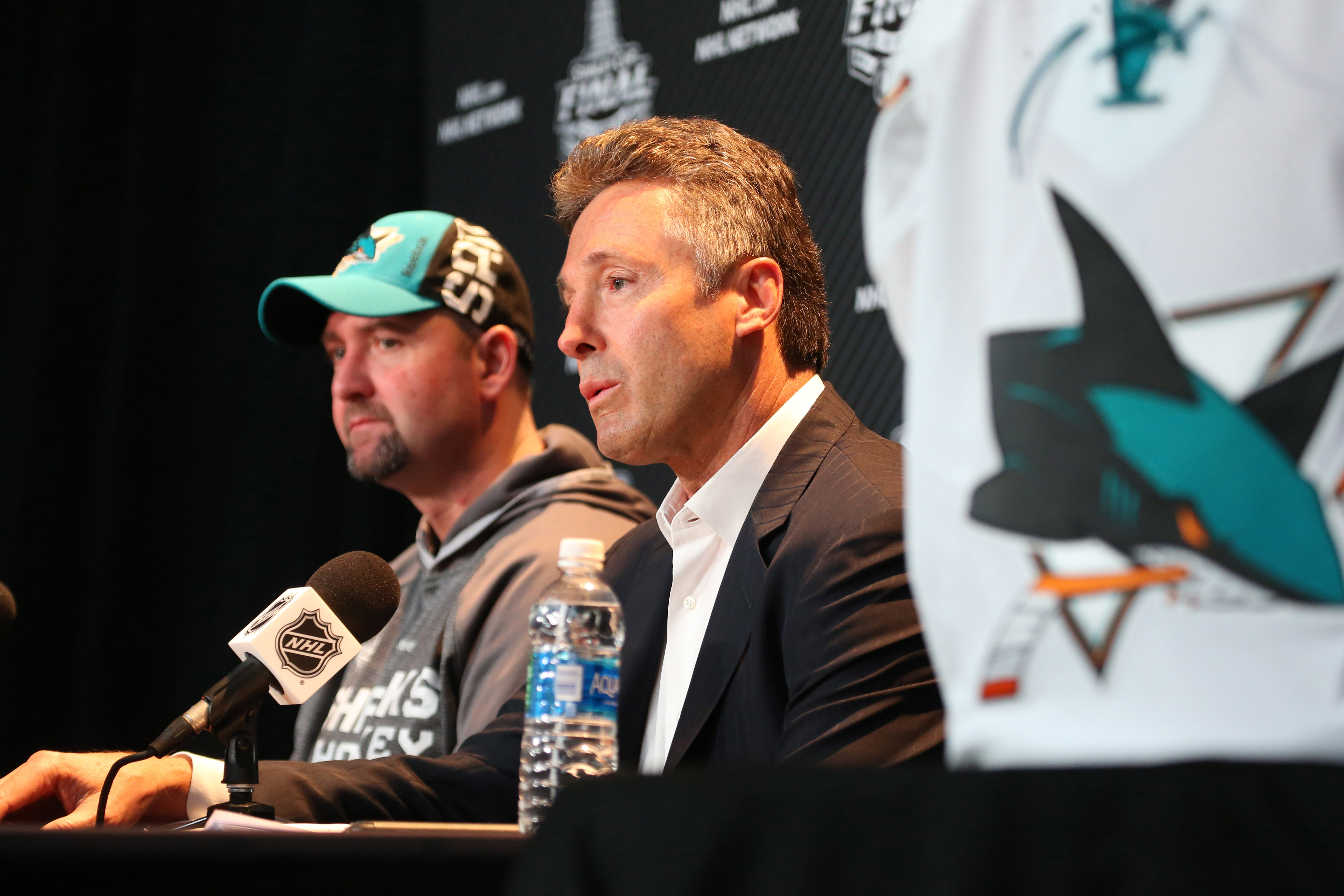 May 29, 2016; Pittsburgh, PA, USA; San Jose Sharks head coach Peter DeBoer (left) and general manager Doug Wilson (right) answer questions during media day a day prior to game one of the 2016 Stanley Cup Final at the CONSOL Energy Center.