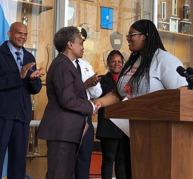Mayor Lori Lightfoot greets student leader at Percy L. Julian High School