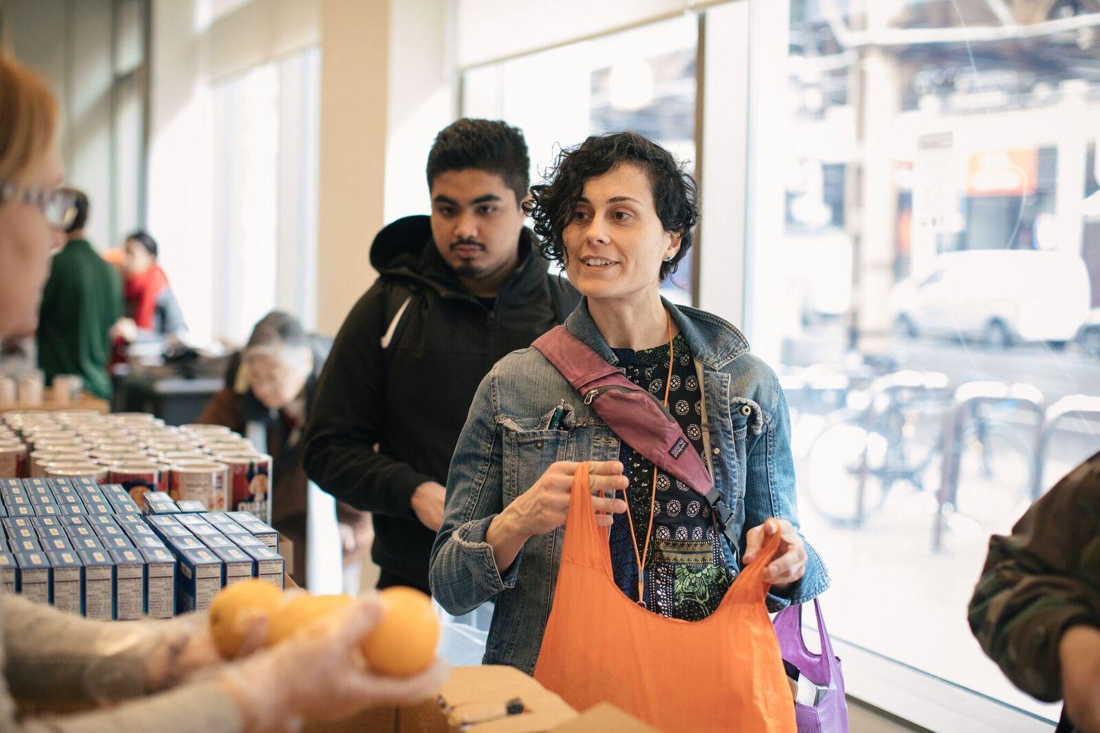 Students take advantage of a food pantry at Harold Washington College in May, 2019.