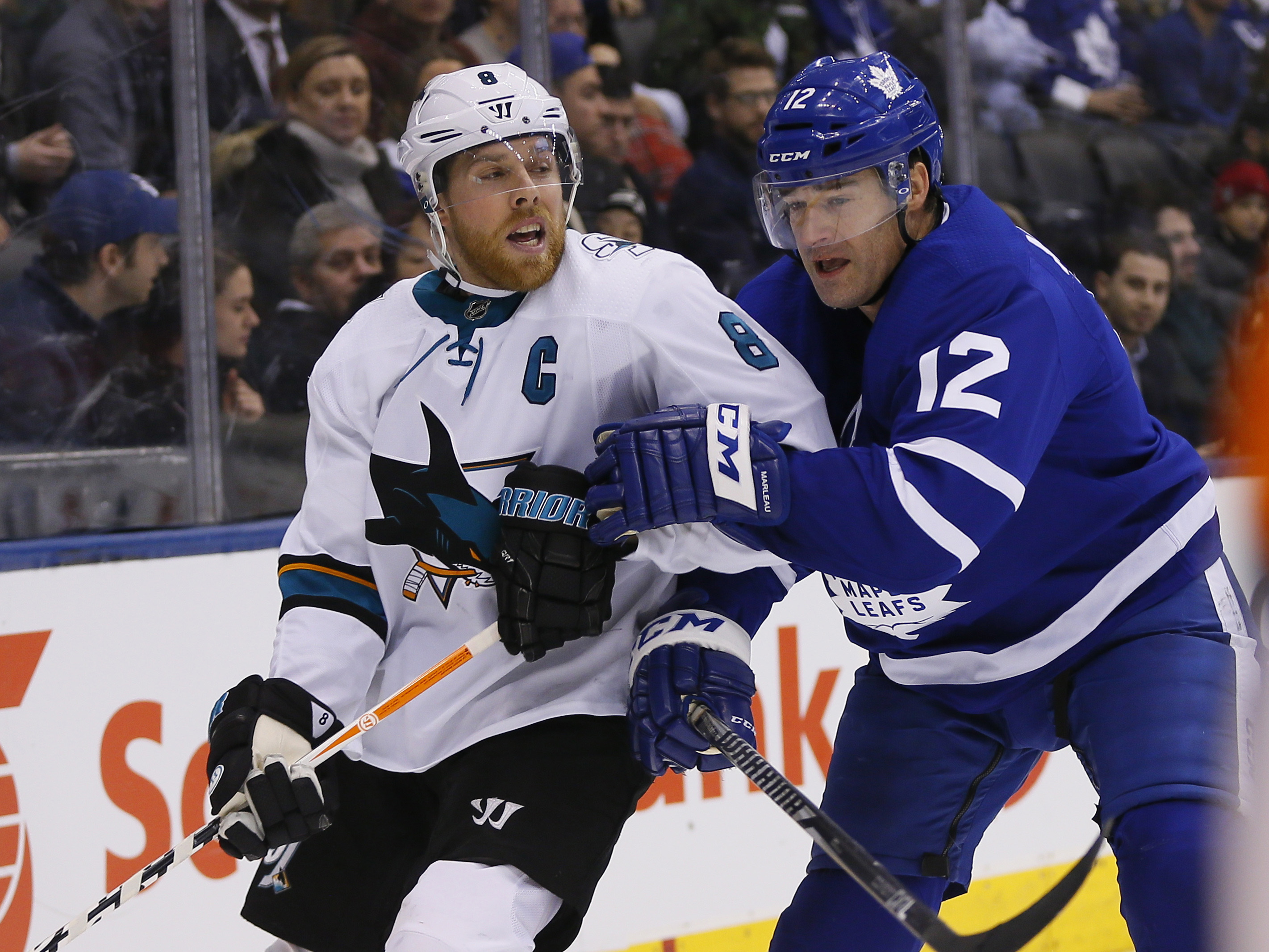 Jan 4, 2018; Toronto, Ontario, CAN; San Jose Sharks forward Joe Pavelski (8) and Toronto Maple Leafs forward Patrick Marleau (12) battle for position at the Air Canada Centre. Toronto defeated San Jose in an overtime shootout.