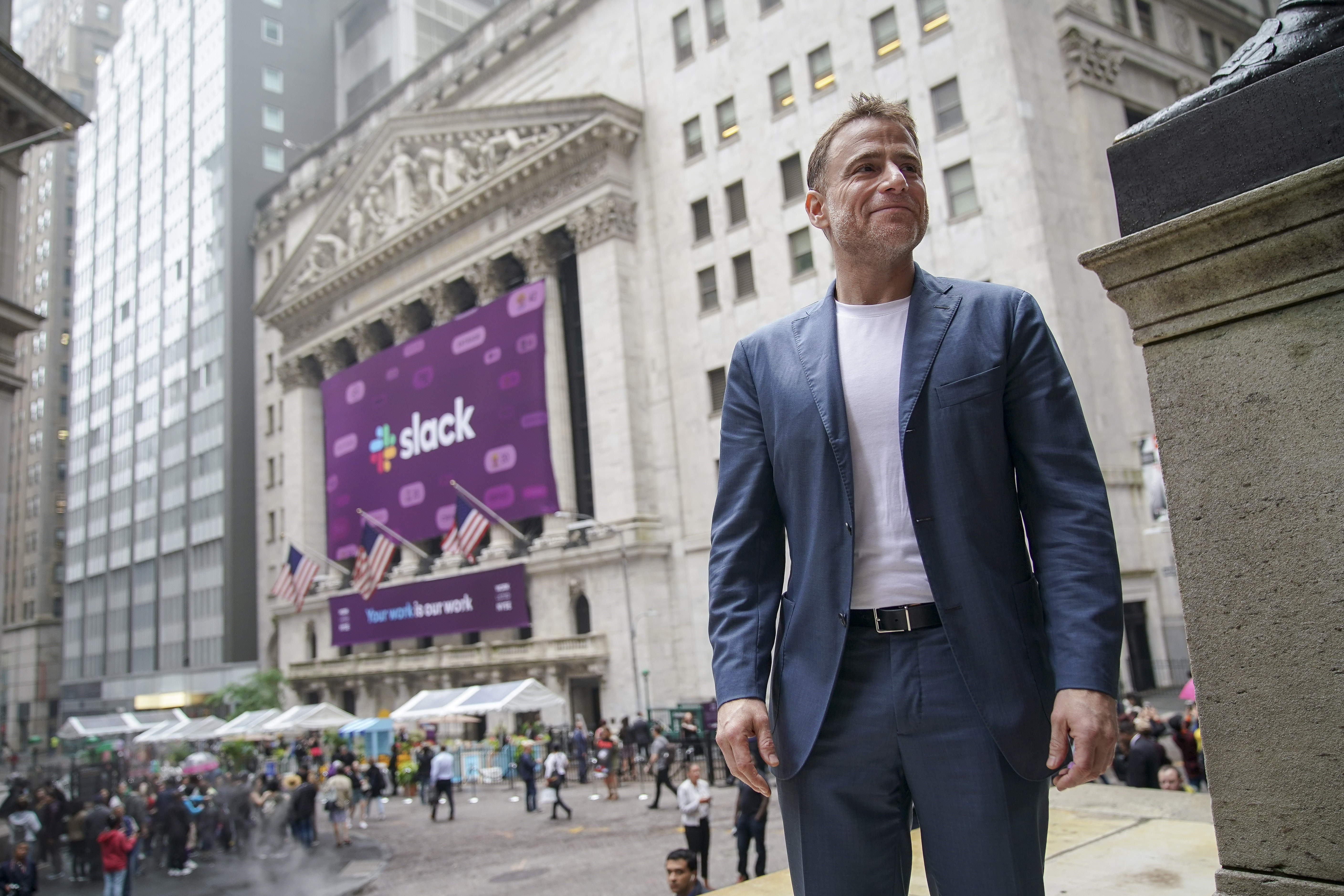 Slack co-founder and CEO Stewart Butterfield standing outside the new York Stock Exchange building.