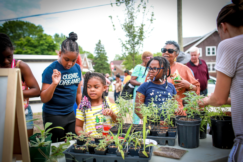 Eastside residents welcome new community rainscape garden in Chandler Park