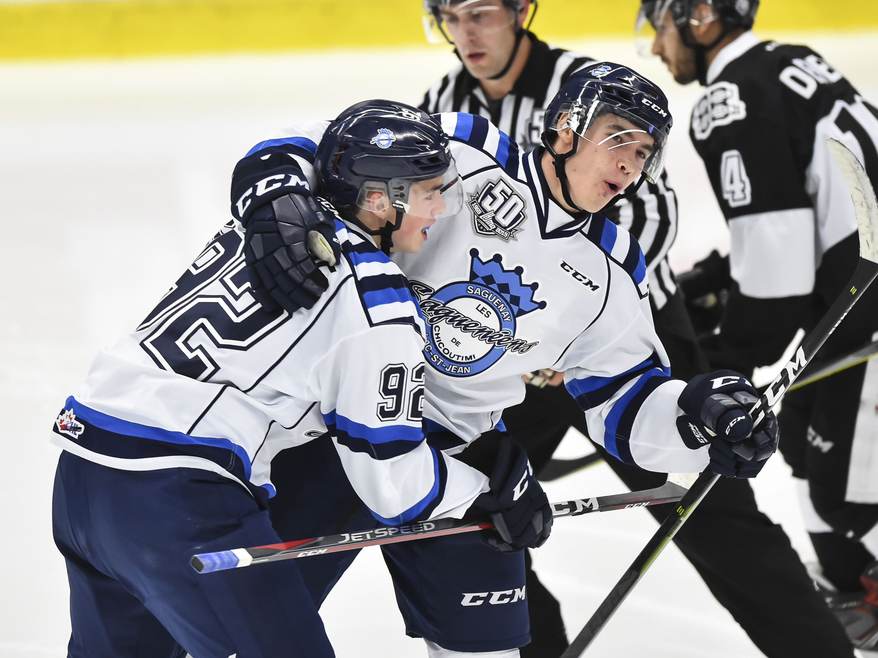 Artemi Kniazev of the Chicoutimi Sagueneens celebrates his second period goal with teammate Hendrix Lapierre against the Blainville-Boisbriand Armada during the QMJHL game at Centre d'Excellence Sports Rousseau on September 28, 2018 in Boisbriand, Quebec,
