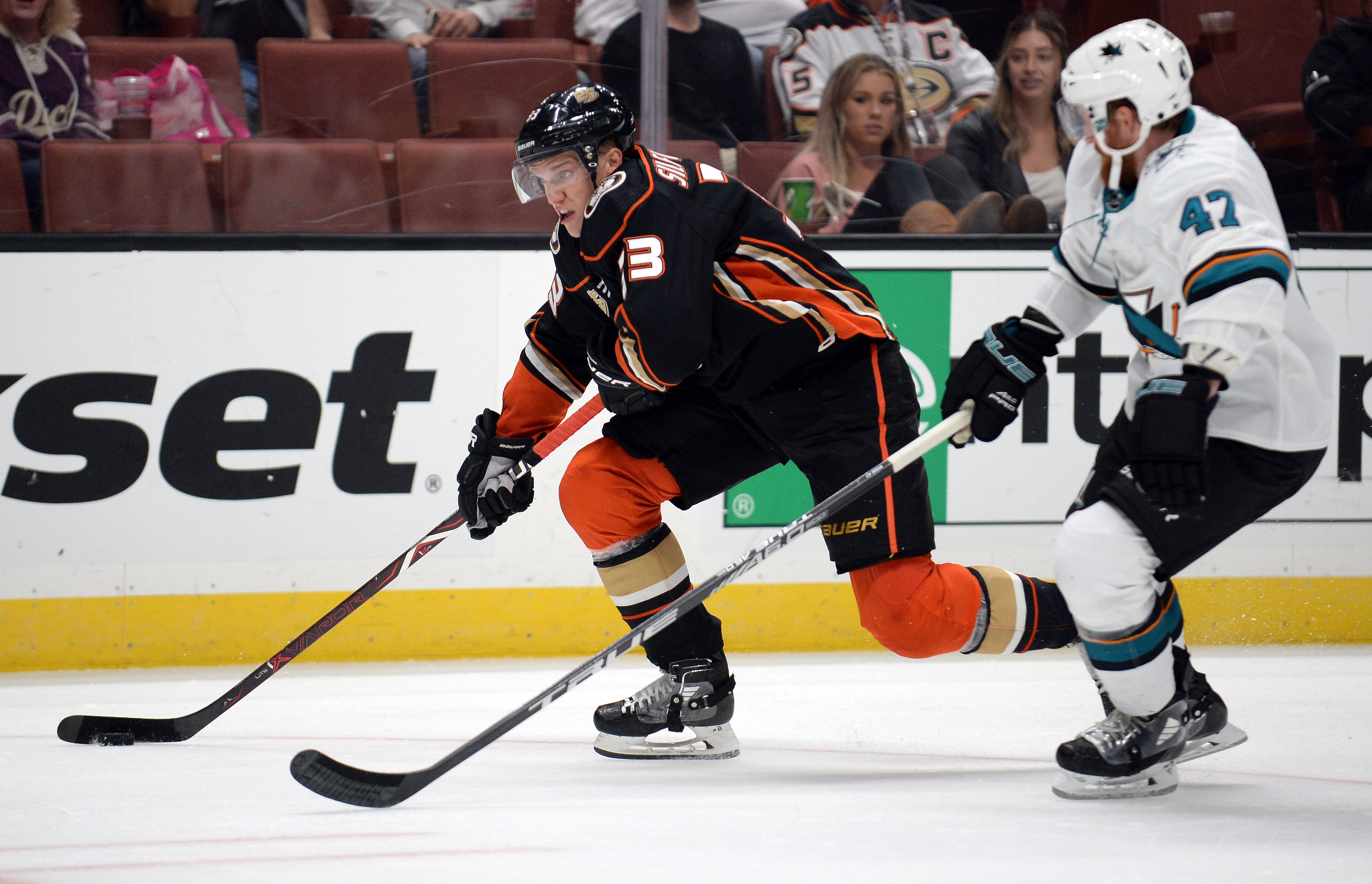 September 20, 2018; Anaheim, CA, USA; Anaheim Ducks right wing Jakob Silfverberg (33) moves the puck against San Jose Sharks left wing Francis Perron (47) during the third period at Honda Center. Mandatory Credit: Gary A. Vasquez