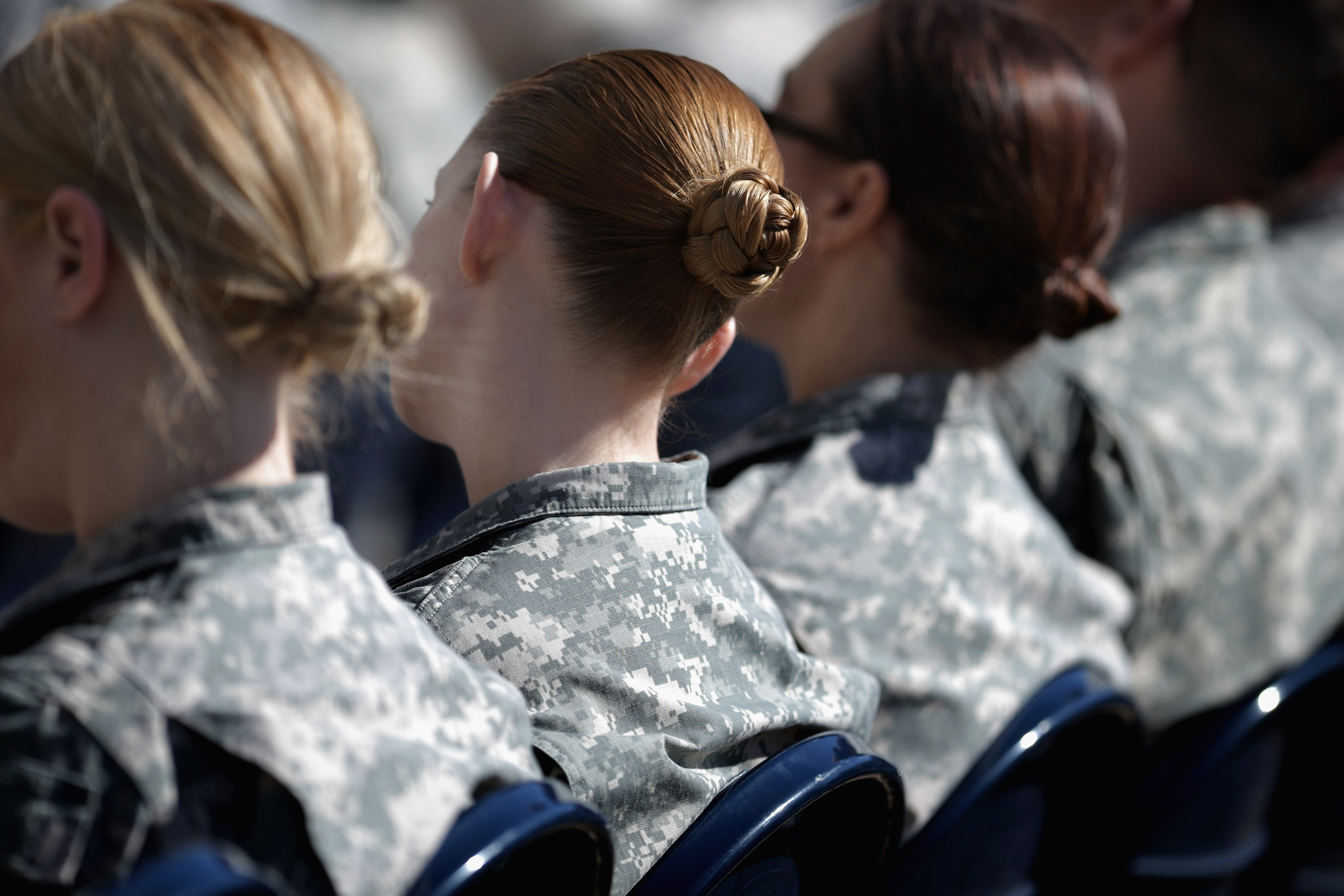 Soldiers, officers, and civilian employees attend the commencement ceremony for the US Army's annual observance of Sexual Assault Awareness and Prevention Month in the Pentagon Center Courtyard March 31, 2015 in Arlington, Virginia.