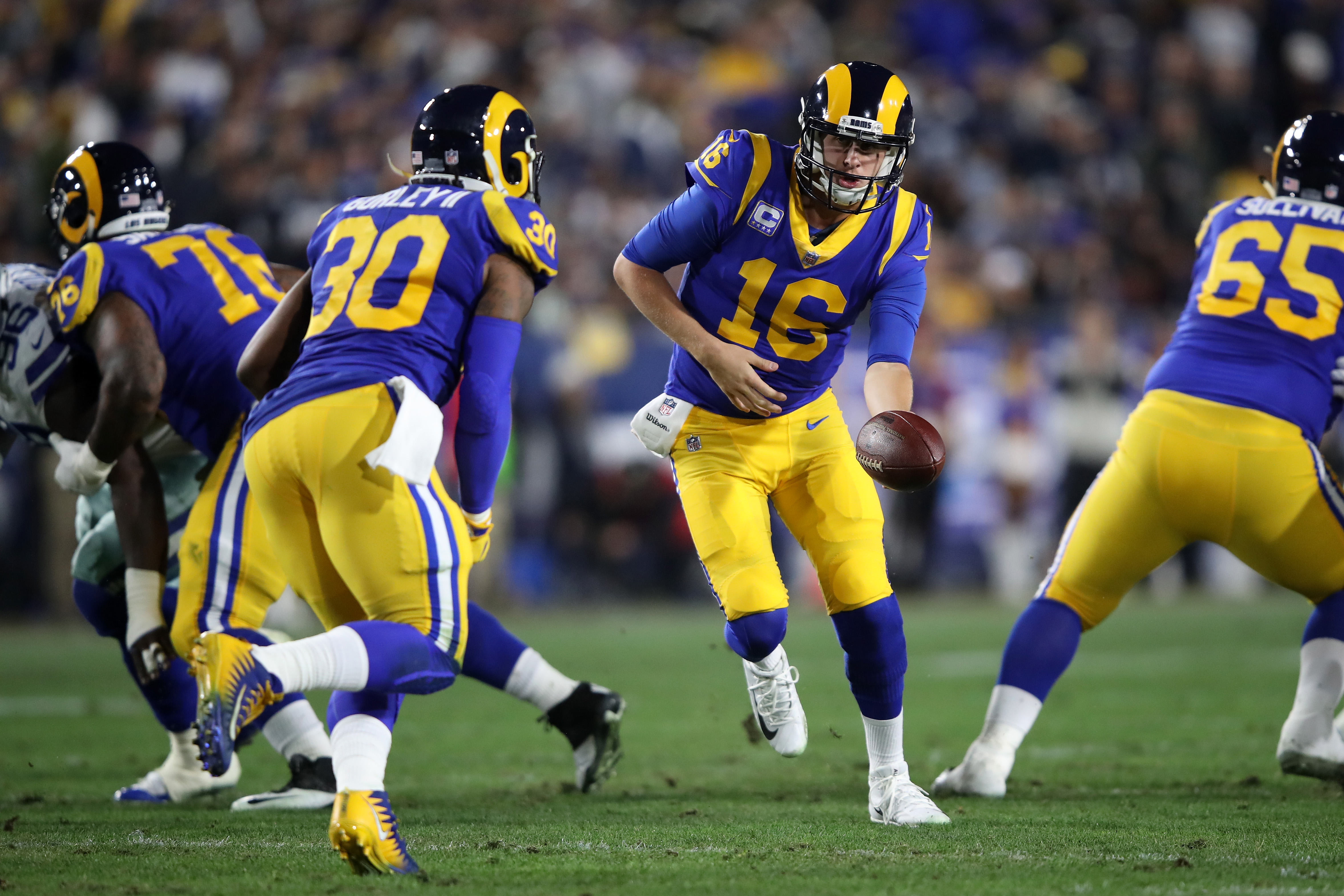 Los Angeles Rams QB Jared Goff hands the ball off to RB Todd Gurley in the NFC Divisional Playoff game against the Dallas Cowboys, Jan. 12, 2019.
