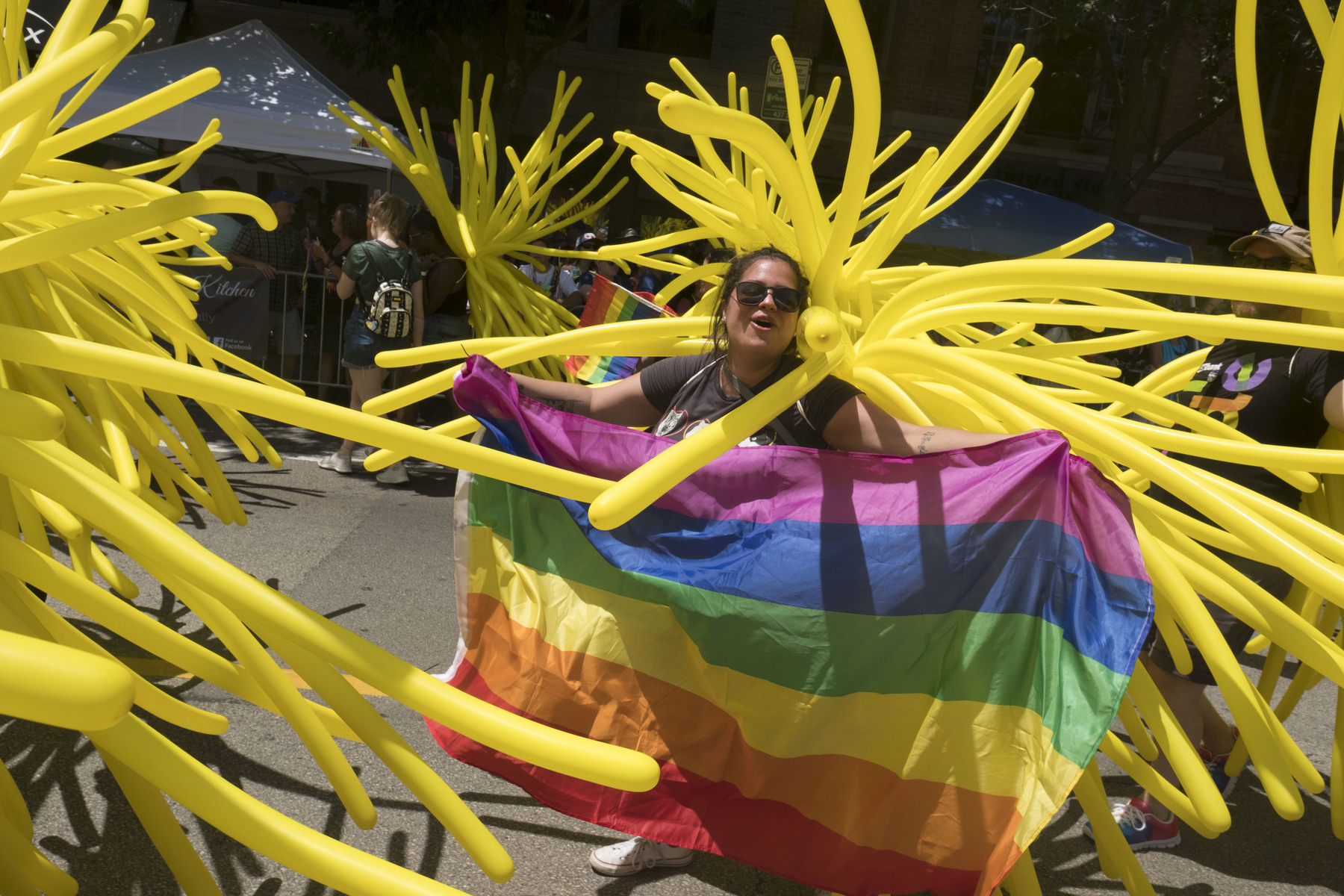 A marcher carries a rainbow flag at last year's Chicago Pride Parade.