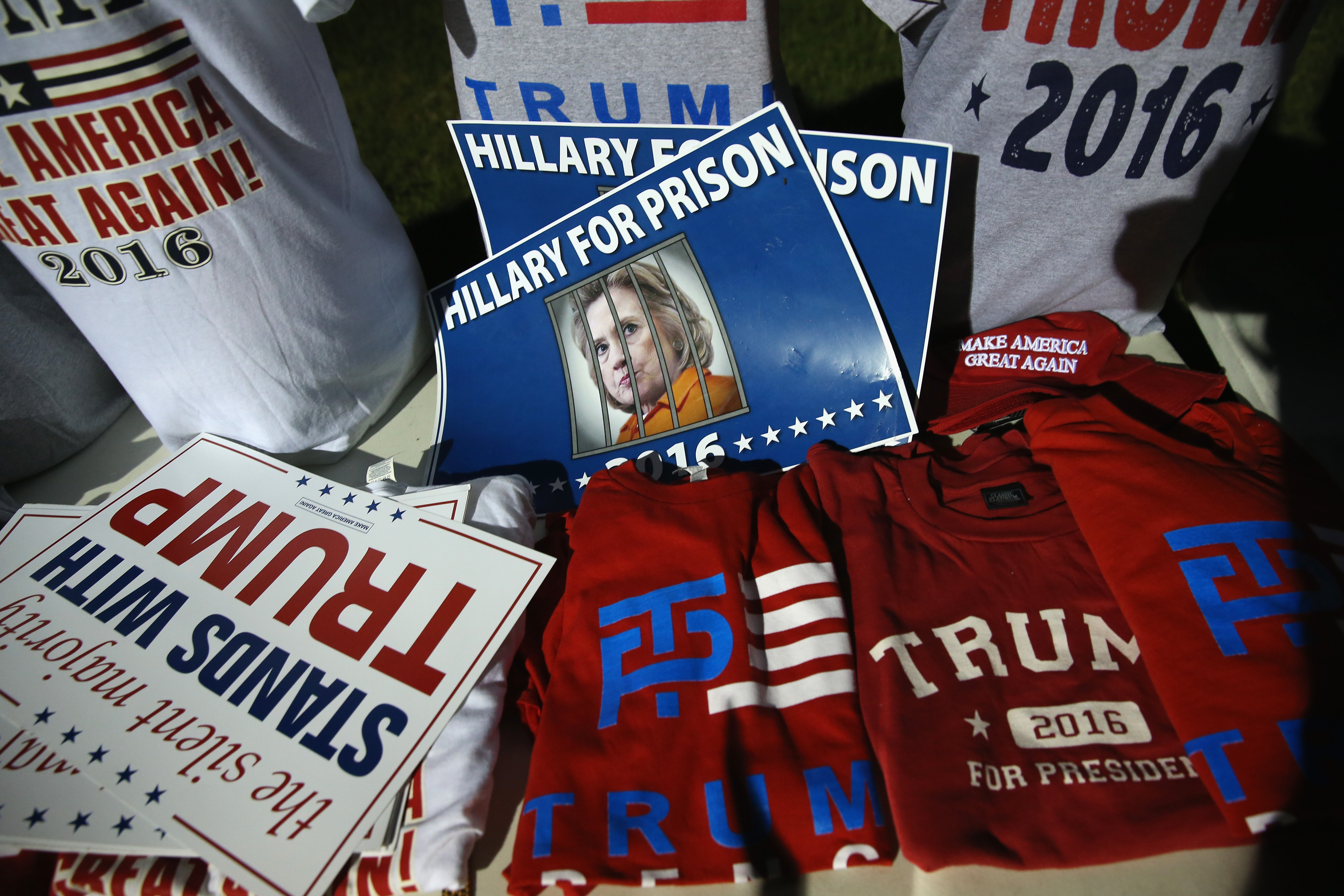 T-shirts and posters sit for sale outside a rally for Republican presidential nominee Donald Trump on August 23, 2016 in Austin, Texas.