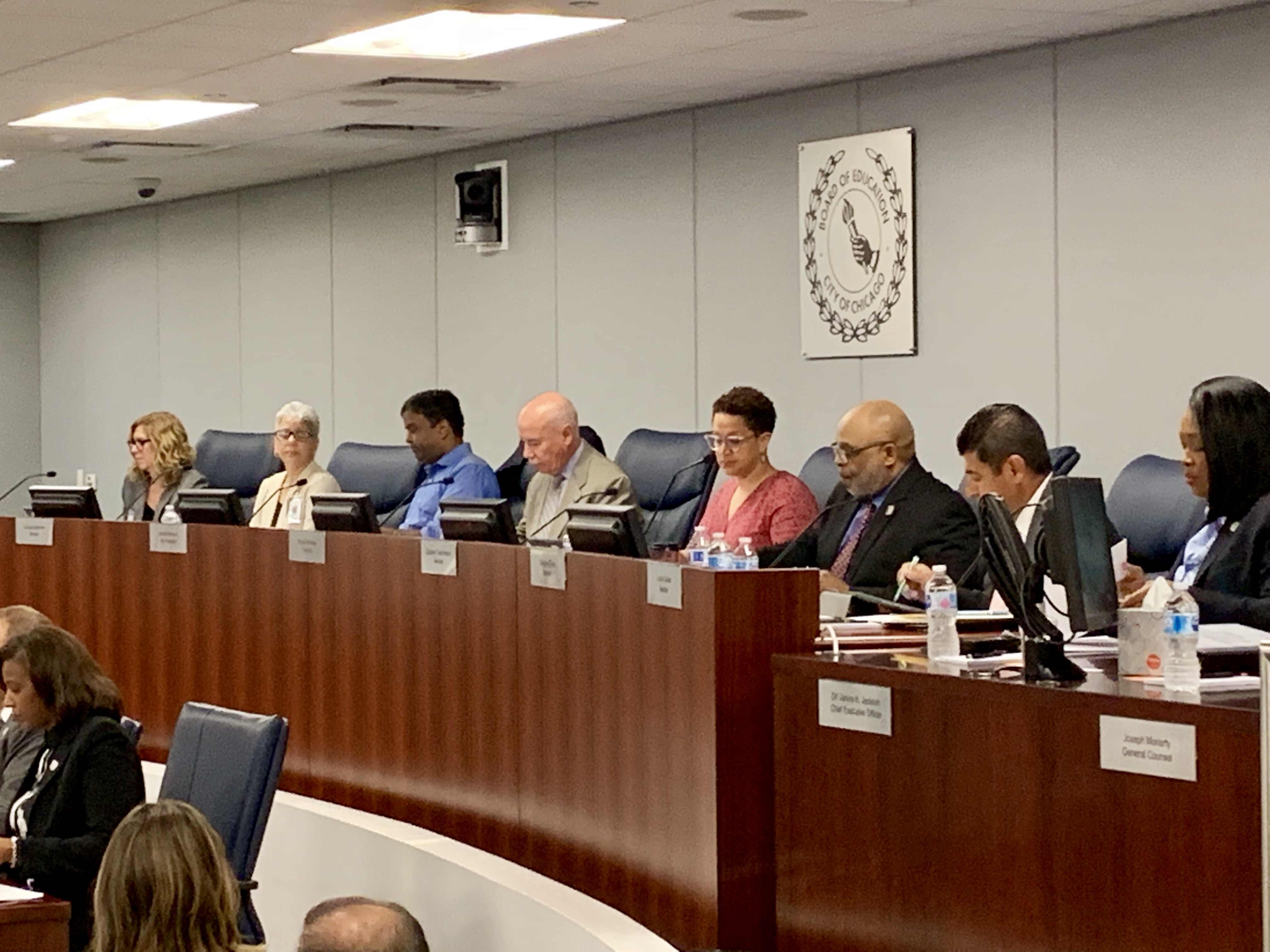 From left: New Chicago Board of Education Members Amy Rome, Luisiana Melendez, Sendhil Revuluri, Miguel del Valle, Elizabeth Todd-Breland, Dwayne Truss and Lucino Sotelo.