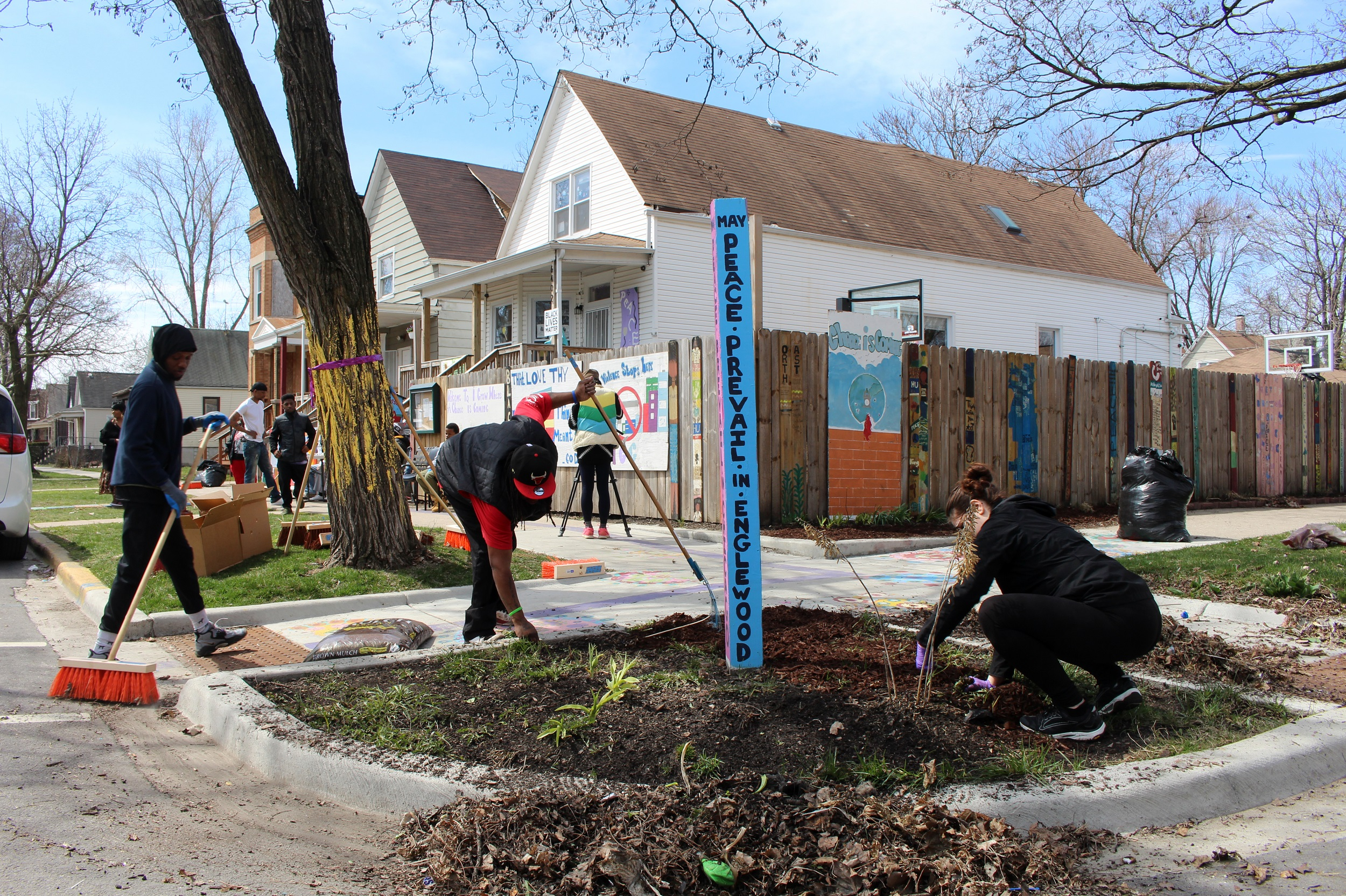 Community members work on the block where the new playground will be in Englewood.