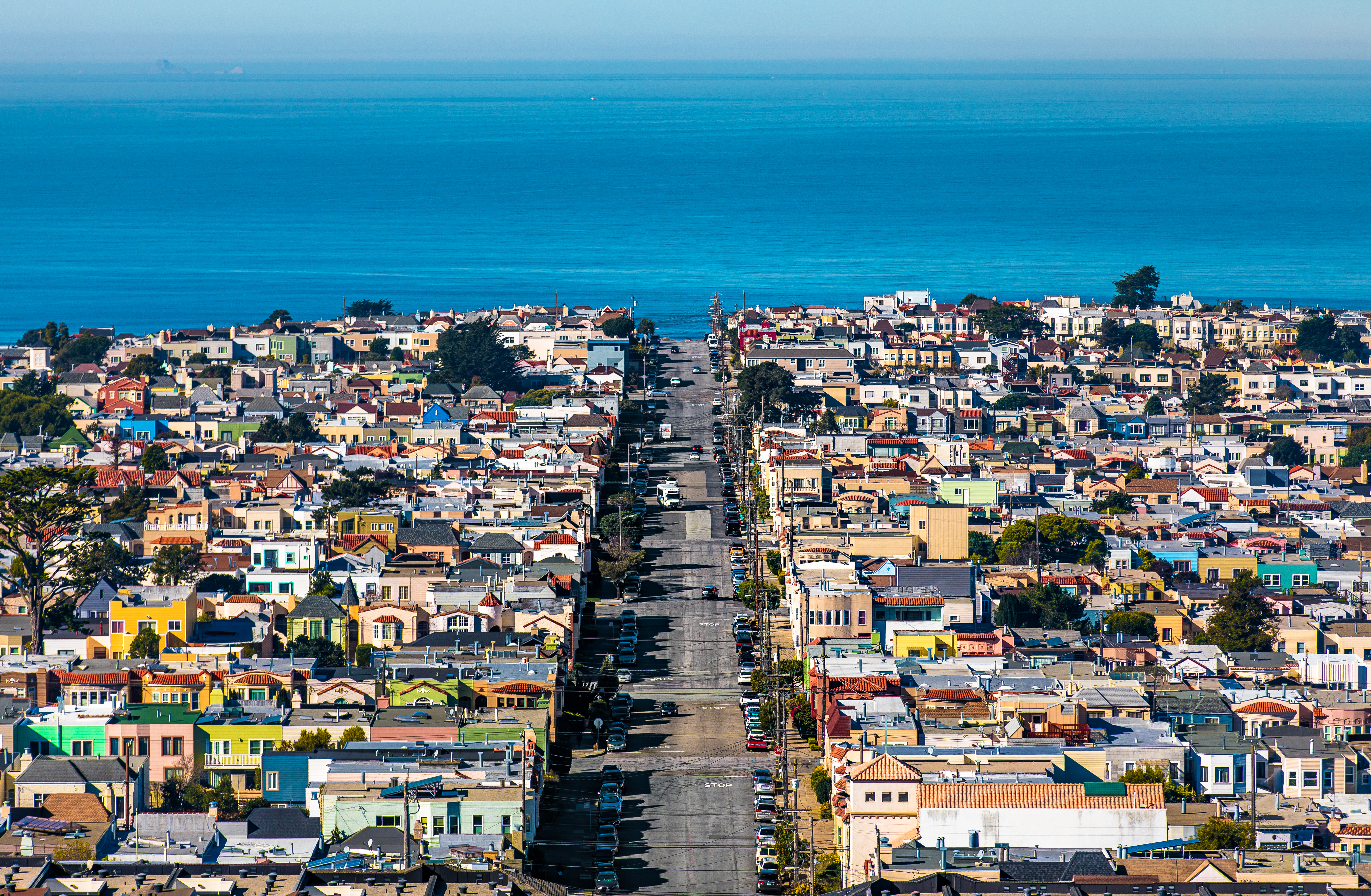 Aerial shot of homes in San Francisco, ocean in the background.