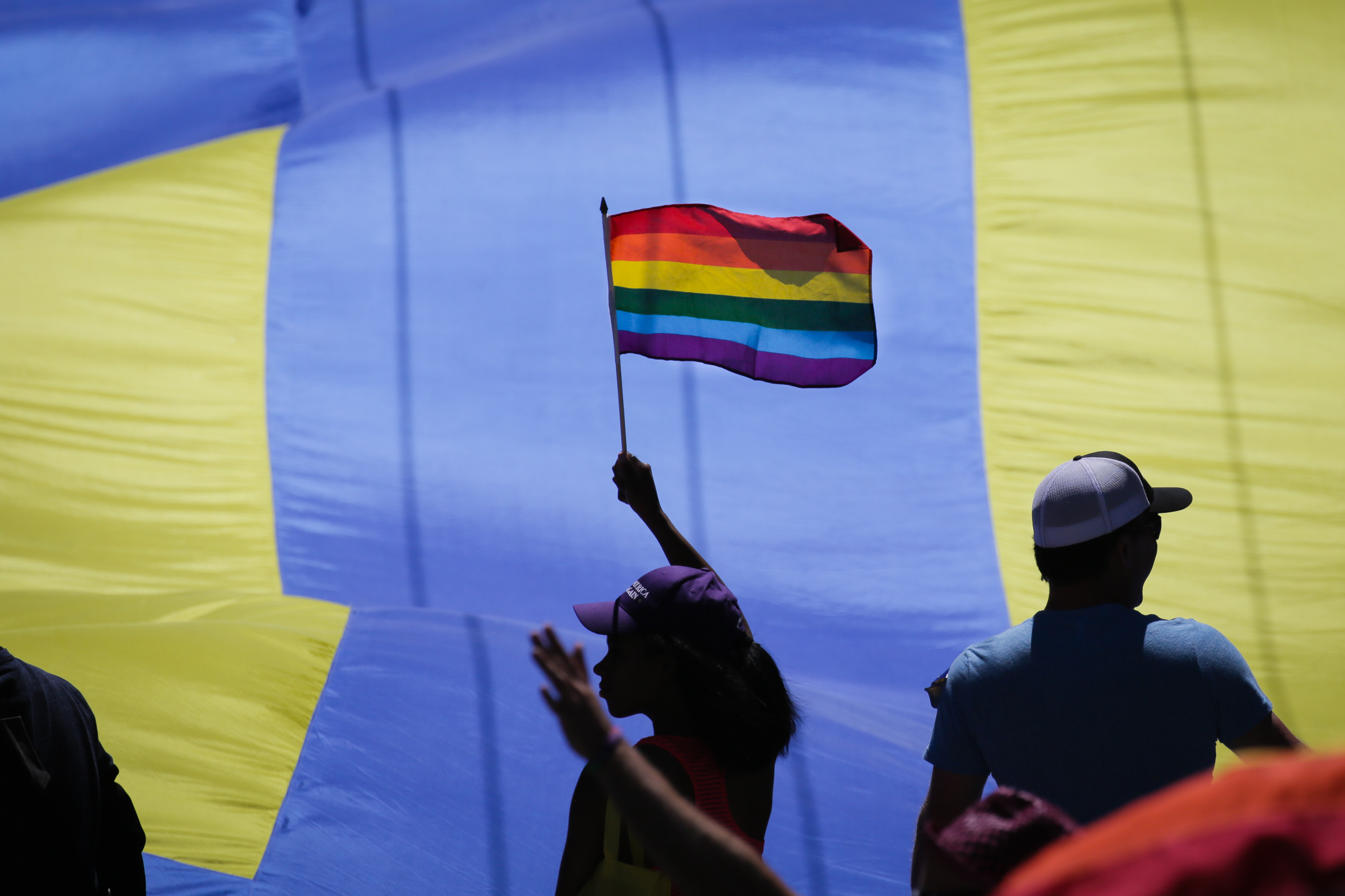 A woman waving a rainbow flag in the annual LGBTQI Pride Parade on Sunday, June 25, 2017, in San Francisco, California.