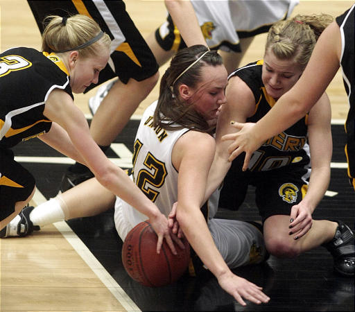 Union's Katie Richens, center, scrambles for the ball between Emery's Tayler Jewkes, left, and Markette Tanner.