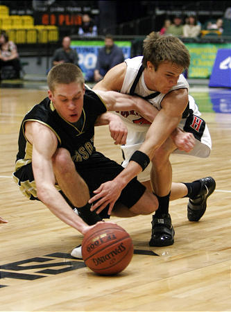 Wasatch's Michael Brown and Hurricane's Zach Sorenson scramble for a loose ball during Friday's contest.