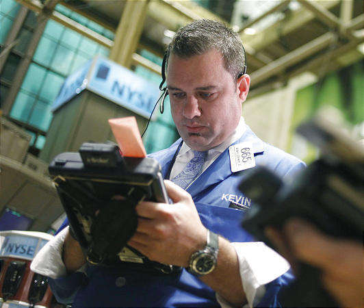 In this May 27, 2010 photo, trader Kevin K. Lodewick works on the floor at the New York Stock Exchange in New York. May was difficult for the stock market as persistent and intensifying worries about Europe's debt problems sent the Dow down 7 percent.