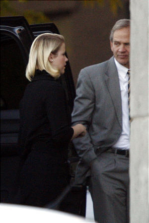 Ed Smart and his daughter, Elizabeth, arrive at court in Salt Lake City on Thursday.