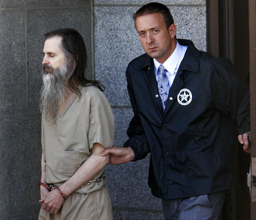 Brian David Mitchell, who is accused of kidnapping Elizabeth Smart, is taken out of federal court in Salt Lake City Thursday.