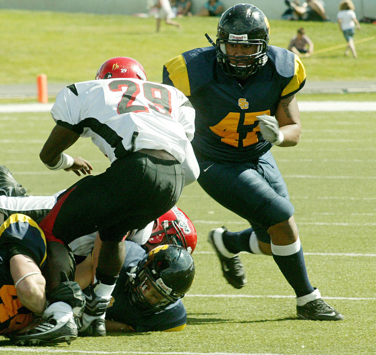 This file photo from Oct. 2009 shows Tenny Palepoi, right, (47) of Snow College.