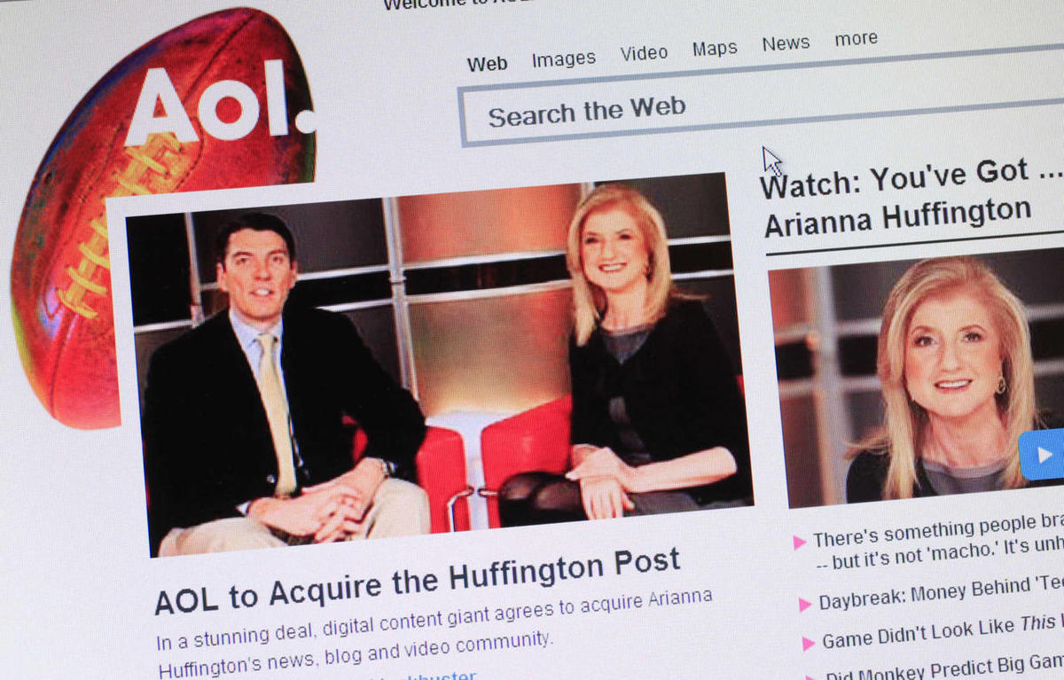 In this 2011 file photos, headlines on AOL\'s website announce that the online company is buying online news hub Huffington Post.