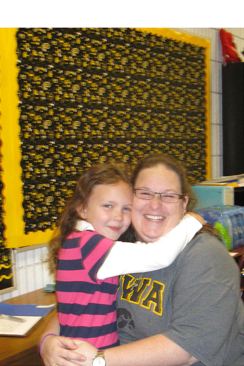 Hannah Kunkel hugs her their-grade teacher Megan Chapman, whom Hannah's mom credits with helping her once-shy daughter to reach her potential in school.