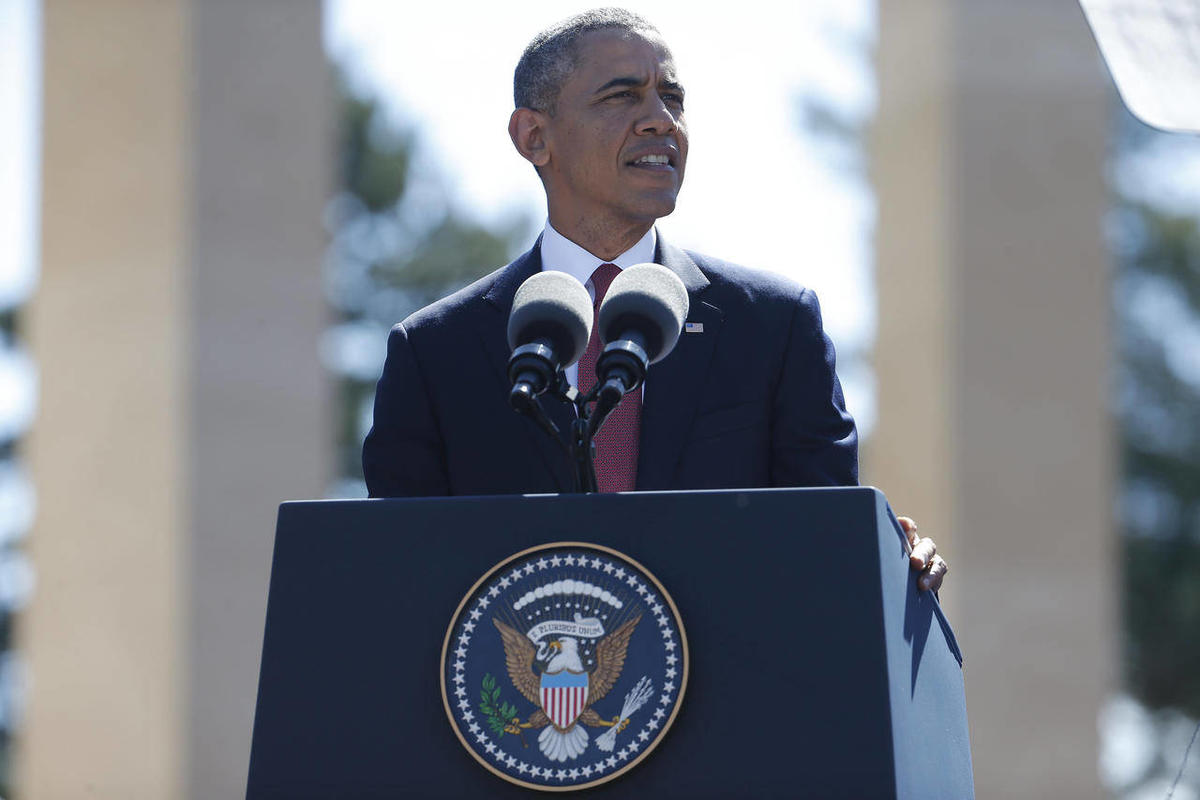 U.S. President Barack Obama  speaks at Normandy American Cemetery at Omaha Beach as he participates in the 70th anniversary of D-Day in Colleville sur Mer in Normandy, France, Friday, June 6, 2014.
