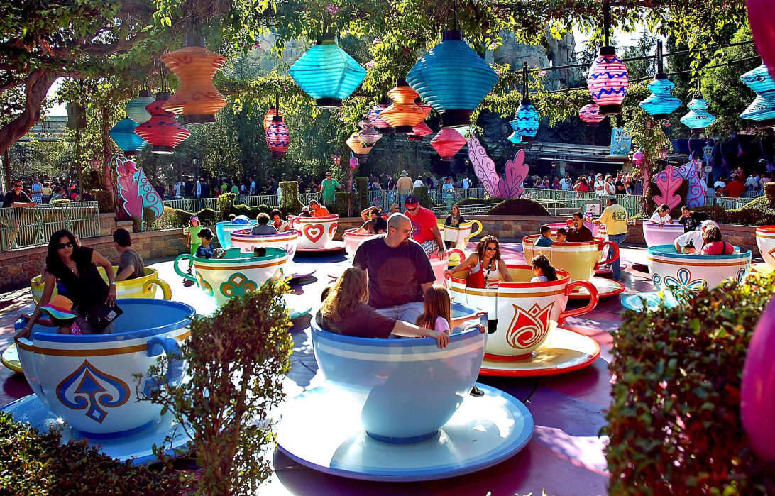 One of the oldest rides in Disneyland, the Mad Tea Party, includes spinning teacups on saucers and operates in Fantasyland.