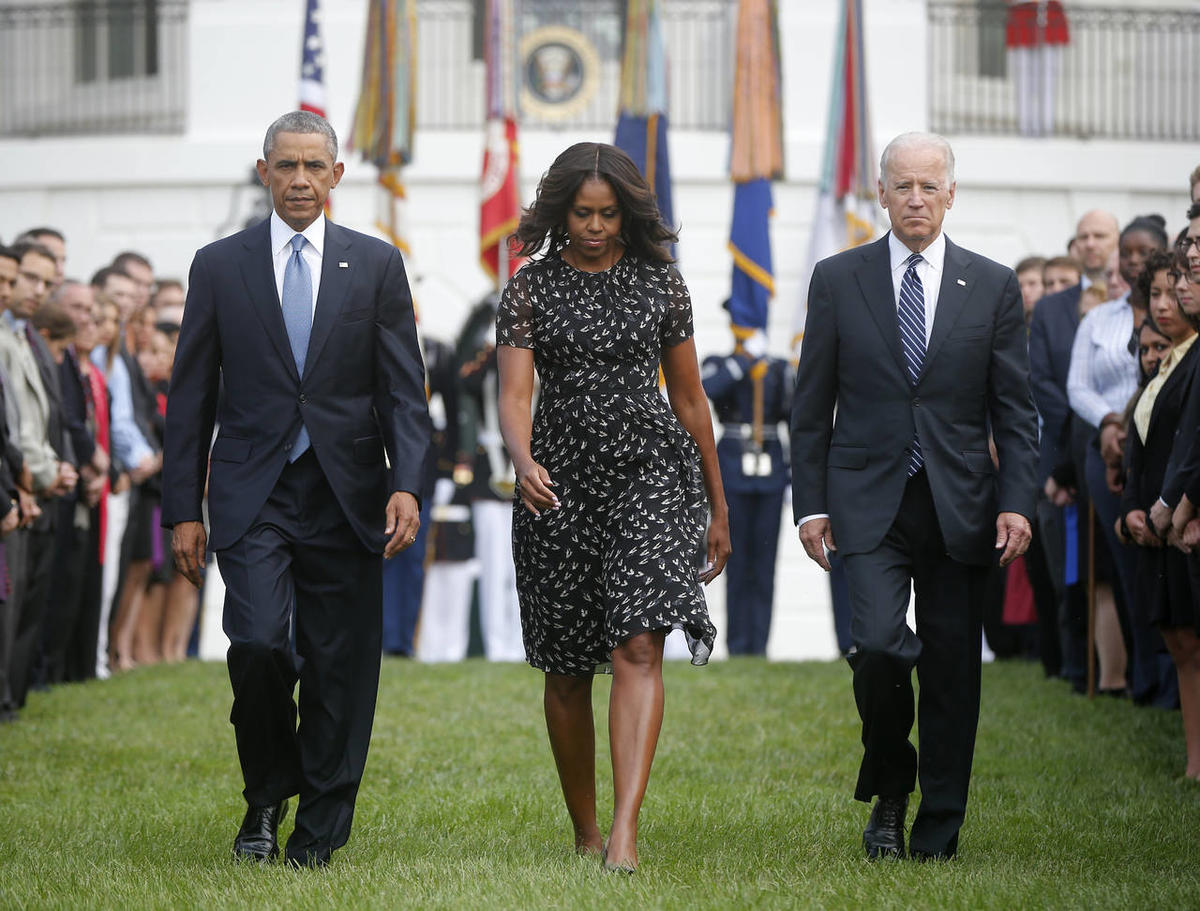 President Barack Obama, first lady Michelle Obama and Vice President Joe Biden walk on the South Lawn of the White House in Washington, Thursday, Sept. 11, 2014, to observe a moment of silence to mark the 13th anniversary of the 9/11 attack.
