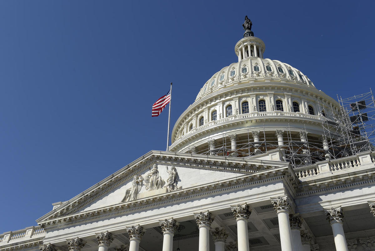 """FILE - In this Tuesday, Sept. 6, 2016, file photo, an American flag flies over Capitol Hill in Washington. A group of six Gulf Arab countries expressed """"deep concern"""" Monday over a bill passed by the U.S. Congress that would allow families of Sept. 11 vic"""