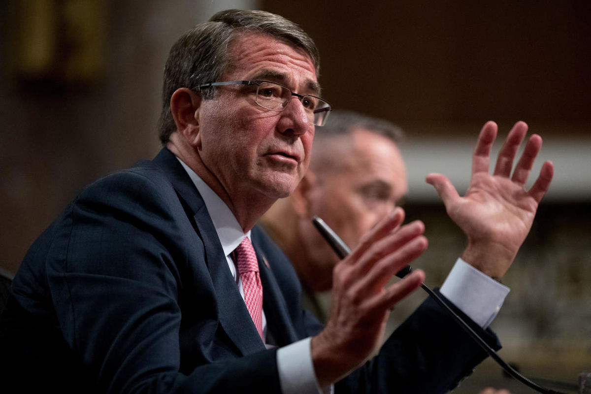 FILE - In this Sept. 22, 2016 file photo, Defense Secretary Ash Carter, accompanied by Joint Chiefs Chairman Gen. Joseph Dunford, testifies on Capitol Hill in Washington. Legislation that would allow the families of Sept. 11 victims to sue the government