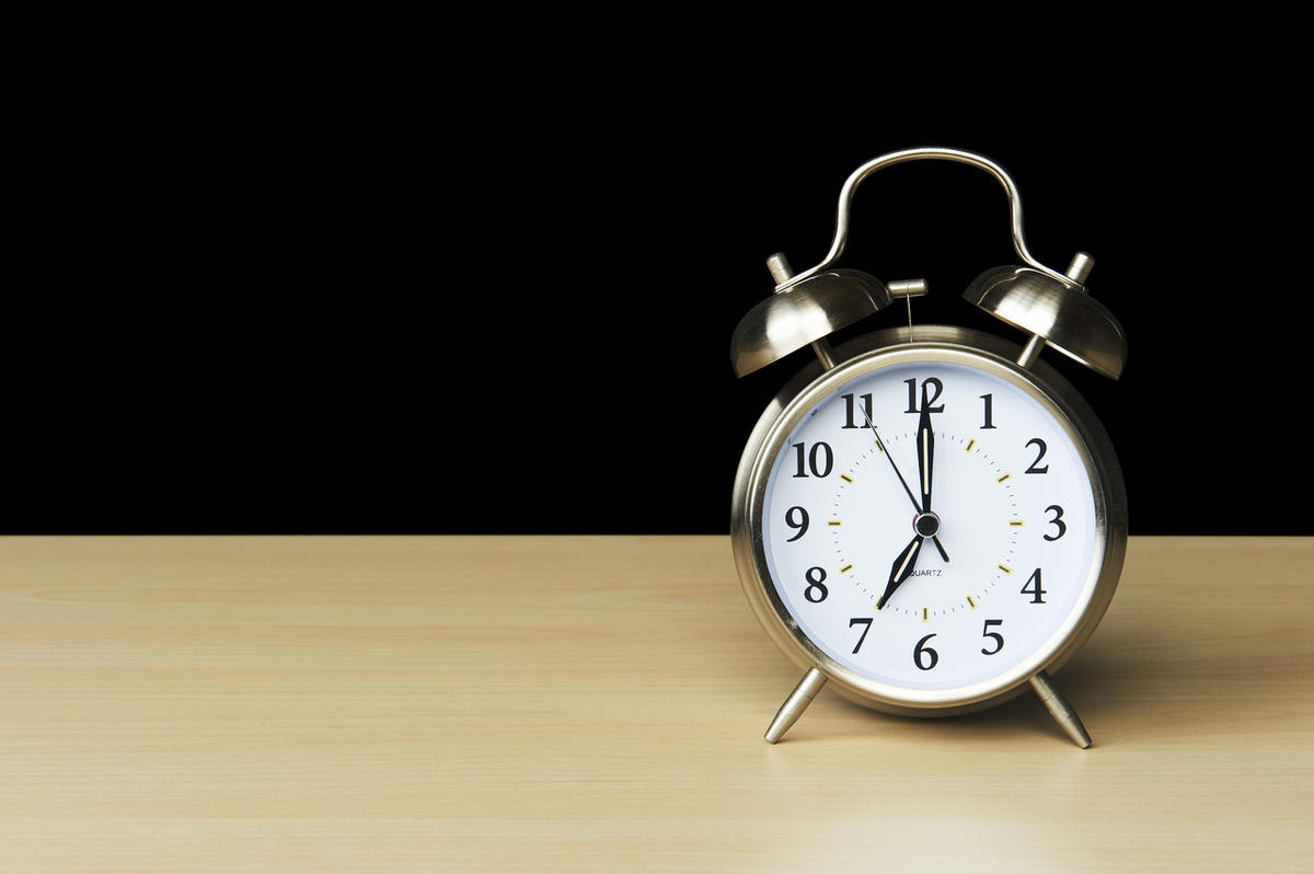 Alarm clock sitting on wood table