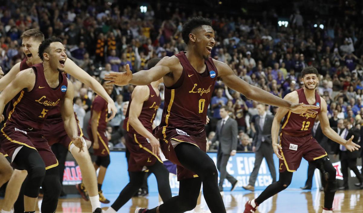 Loyola-Chicago players celebrate after winning a regional final NCAA college basketball tournament game against Kansas State, Saturday, March 24, 2018, in Atlanta. Loyola-Chicago won 78-62. (AP Photo/David Goldman)