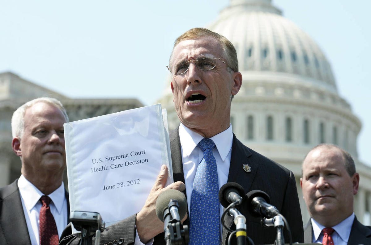 FILE - In this Thursday, June 28, 2012 file photo, Rep. Tim Murphy, R-Pa., center, holds up a copy of the Supreme Court's health care ruling during a news conference by the GOP Doctors Caucus on Capitol Hill in Washington. Medicaid advocates are on pins a