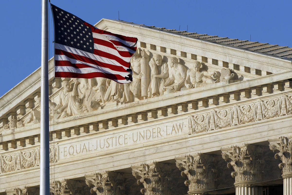 This June 27, 2012 file photo shows an American flag flying in front of the Supreme Court in Washington.
