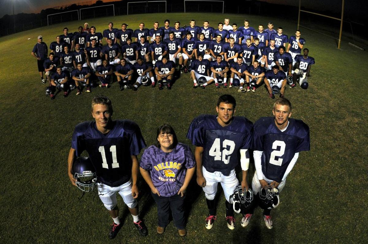 Chy Johnson and the Queen Creek High School varsity football team. Members of the football team took Johnson, a special needs student, under their wing after they learned she was being tormented by bullies.