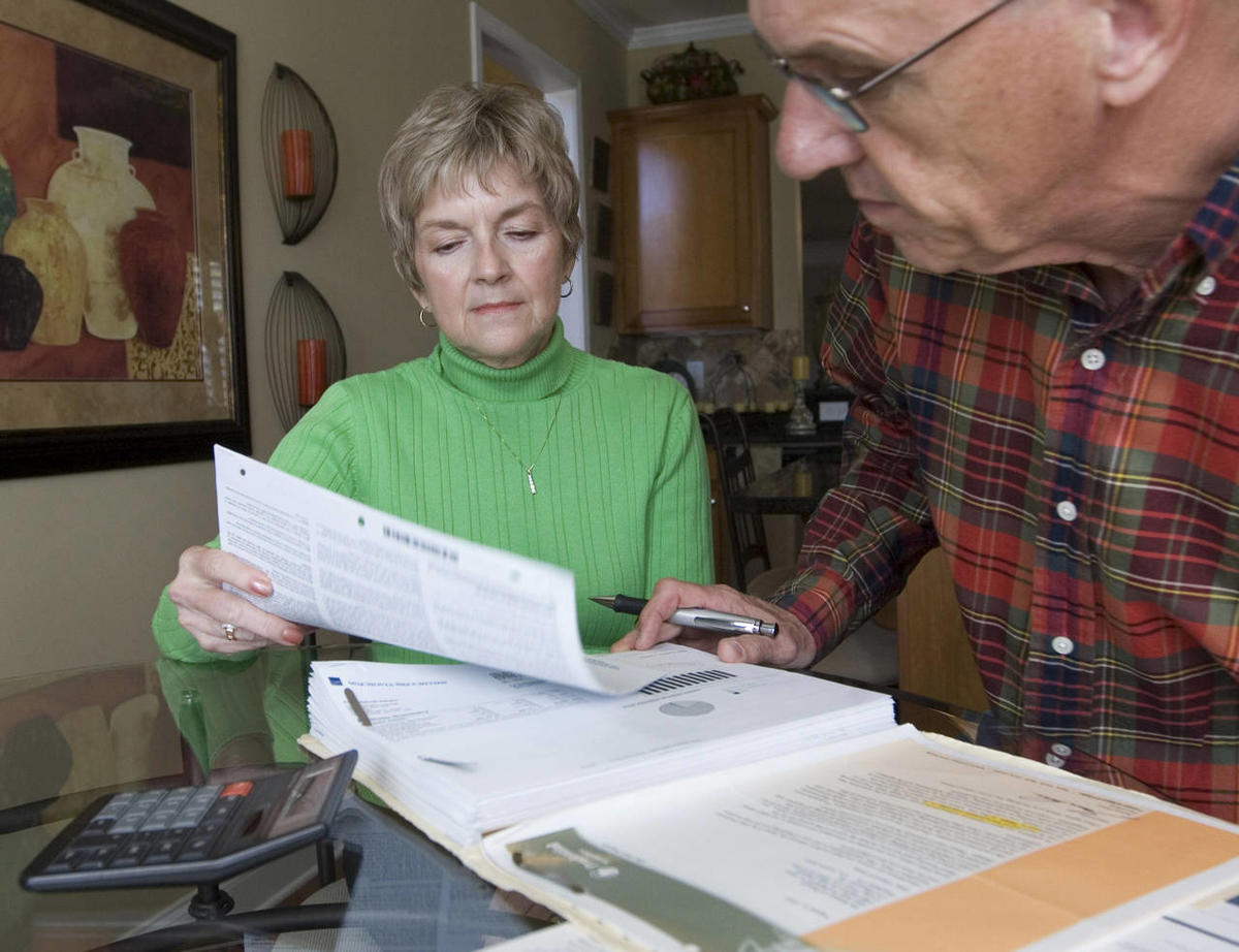 Judy and Bob Dienell review their financial statements  Saturday, Oct. 25, 2008, in Braselton, Ga.