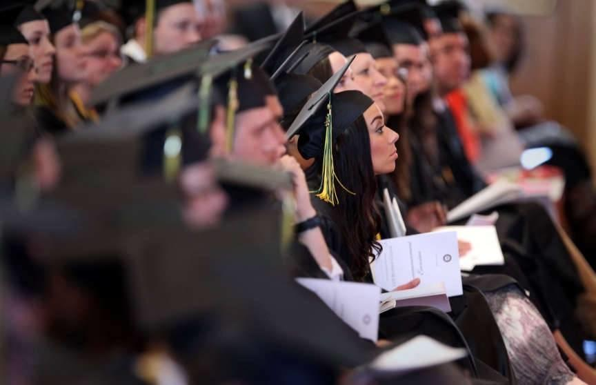 Graduates listen to a commencement address during LDS Business College's 126th commencement ceremony in the Tabernacle on Temple Square in Salt Lake City on Friday, April 12, 2013. According to a study, starting salaries for college graduates increased be