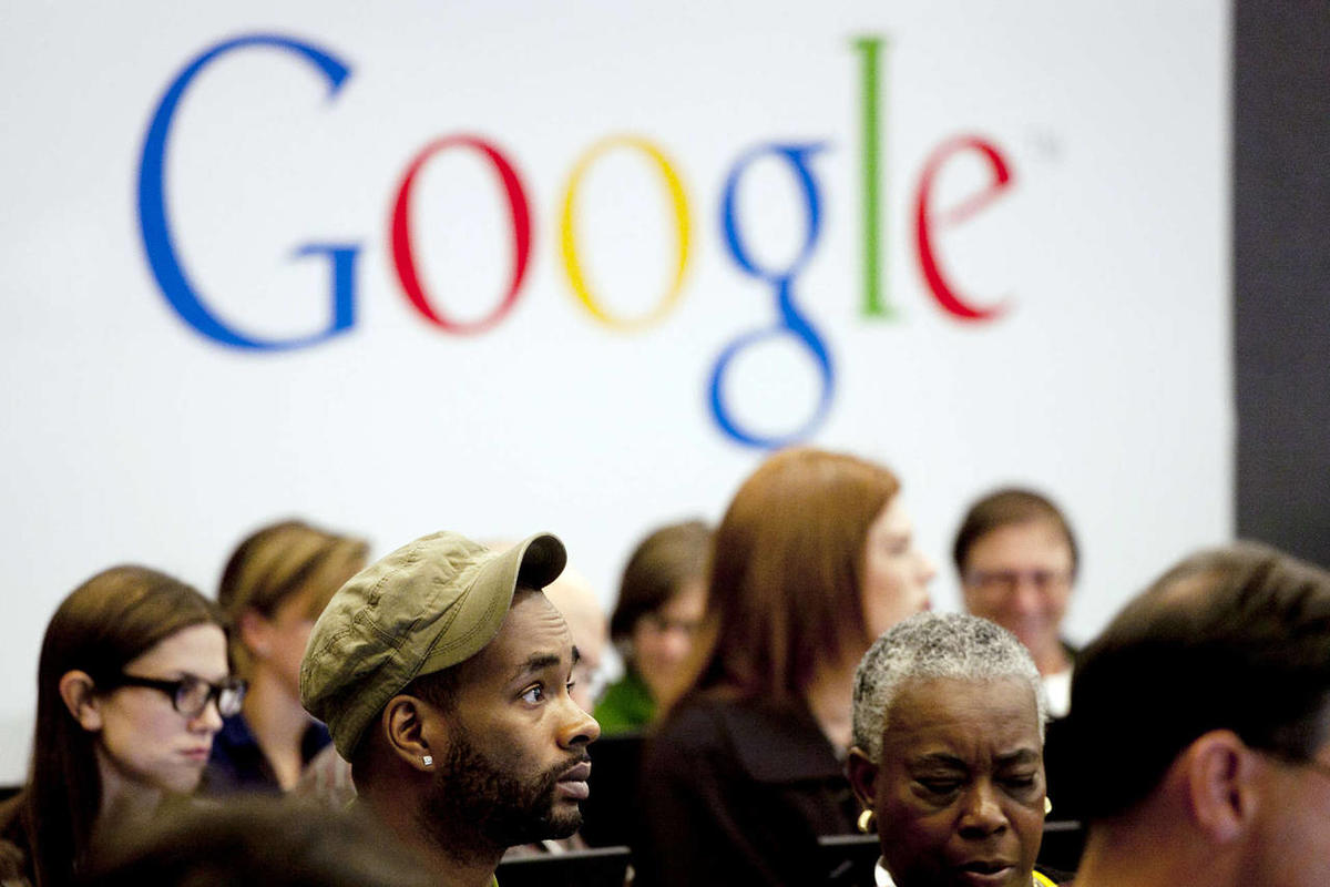 """In this Wednesday, Oct. 17, 2012, file photo, people attend a workshop, """"New York Get Your Business Online,"""" at Google offices in New York."""