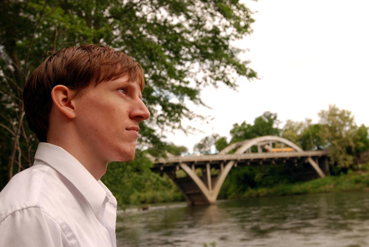 Oregon State University graduate Josh Donahue, 23, stands at the edge of the Rogue River in his home town of Grants Pass, Ore., Tuesday, May 19, 2009. A new Pew study shows that the number of young adults — ages 18 to 31 — who live with their parents cont
