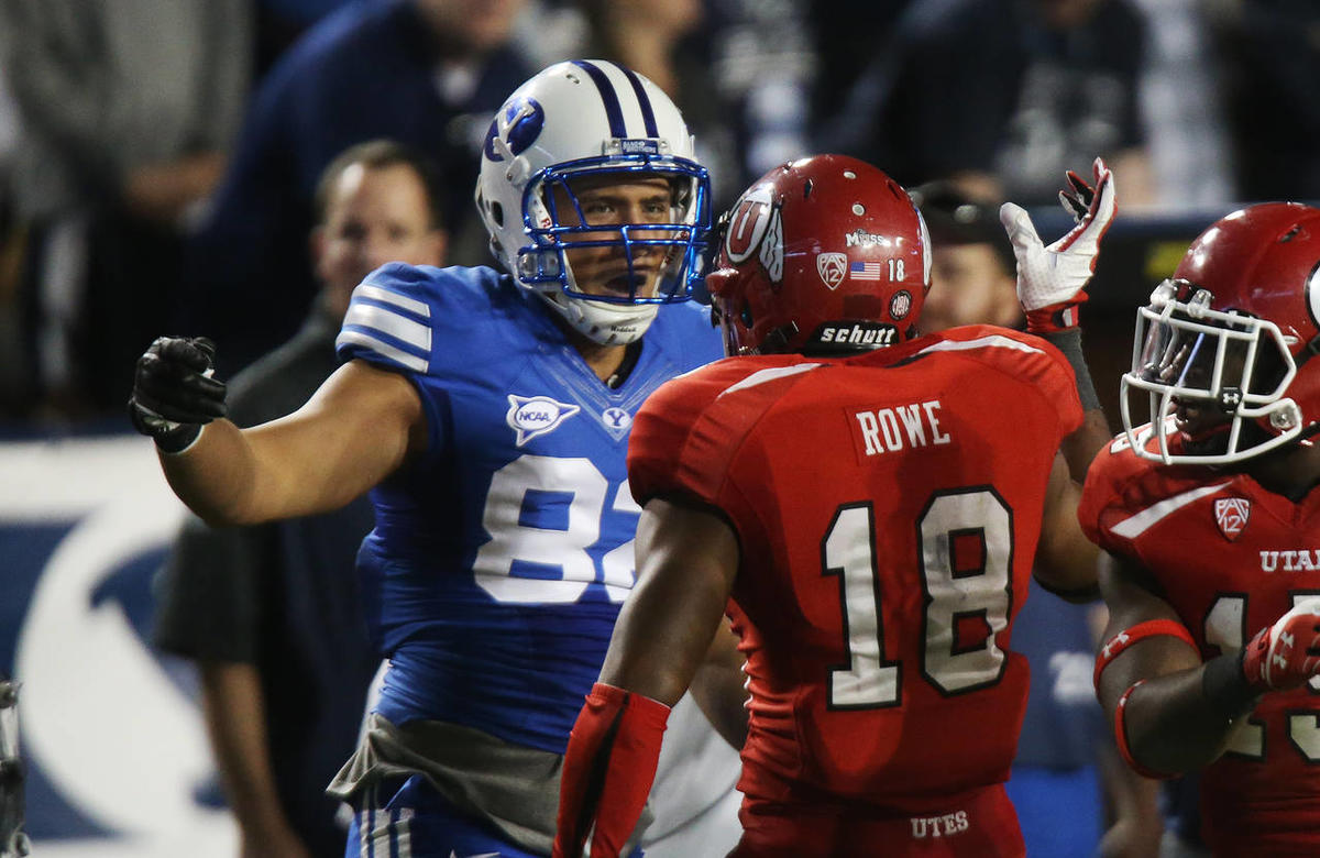 Utah Utes defensive back Eric Rowe (18) was called for an unsportsmanslike penalty on Brigham Young Cougars tight end Kaneakua Friel (82)  during NCAA football in Provo  Sunday, Sept. 22, 2013.  Utah won 20-13.