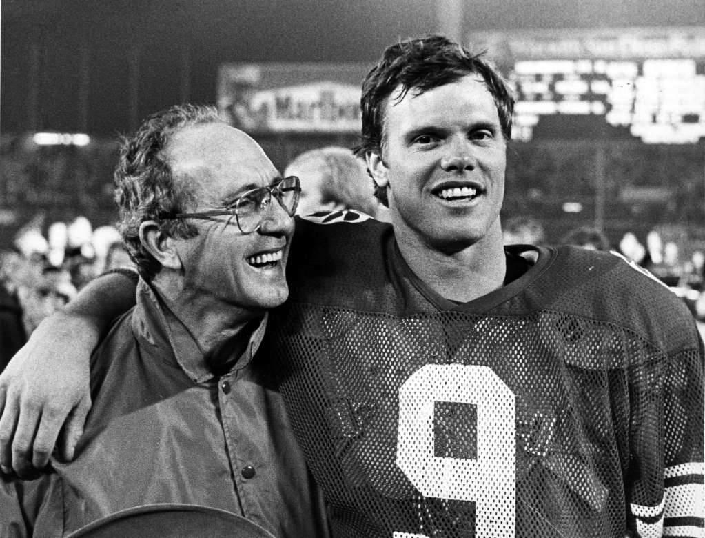 Jim McMahon Sr. is all smiles, as is his son, who threw the winning touchdown. (Photo by Tom Smart, Deseret News Archives)