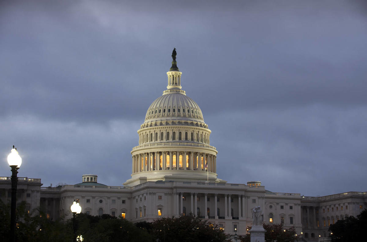 The U.S. Capitol is seen under an overcast sky at dawn, Monday, Oct. 7, 2013, at the Capitol in Washington.