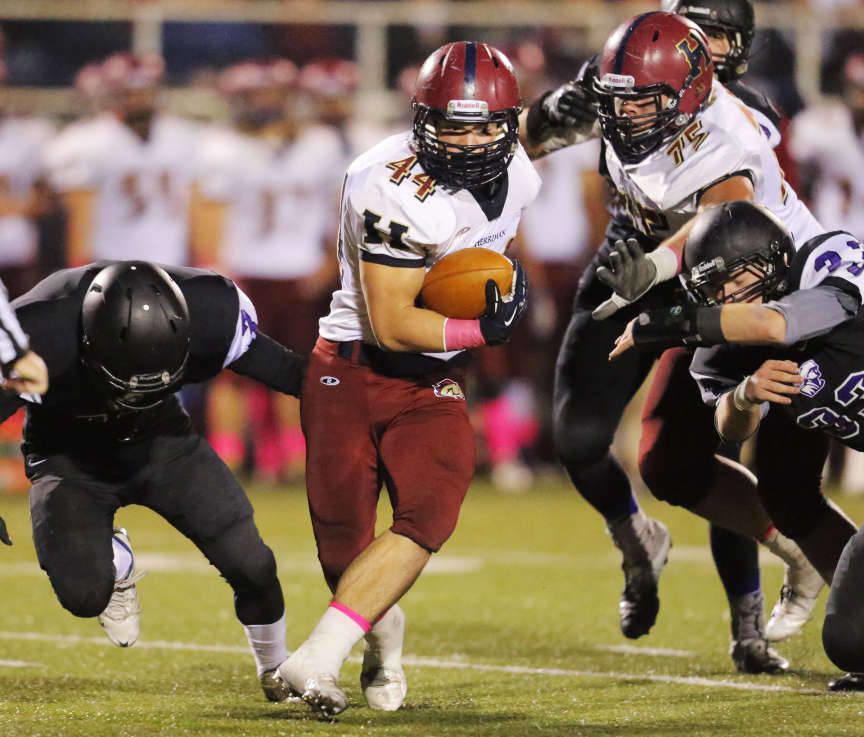 Herriman's Beau Bequette spins and twists during a run as Lehi and Herriman play Wednesday, Oct. 16, 2013 in Lehi.
