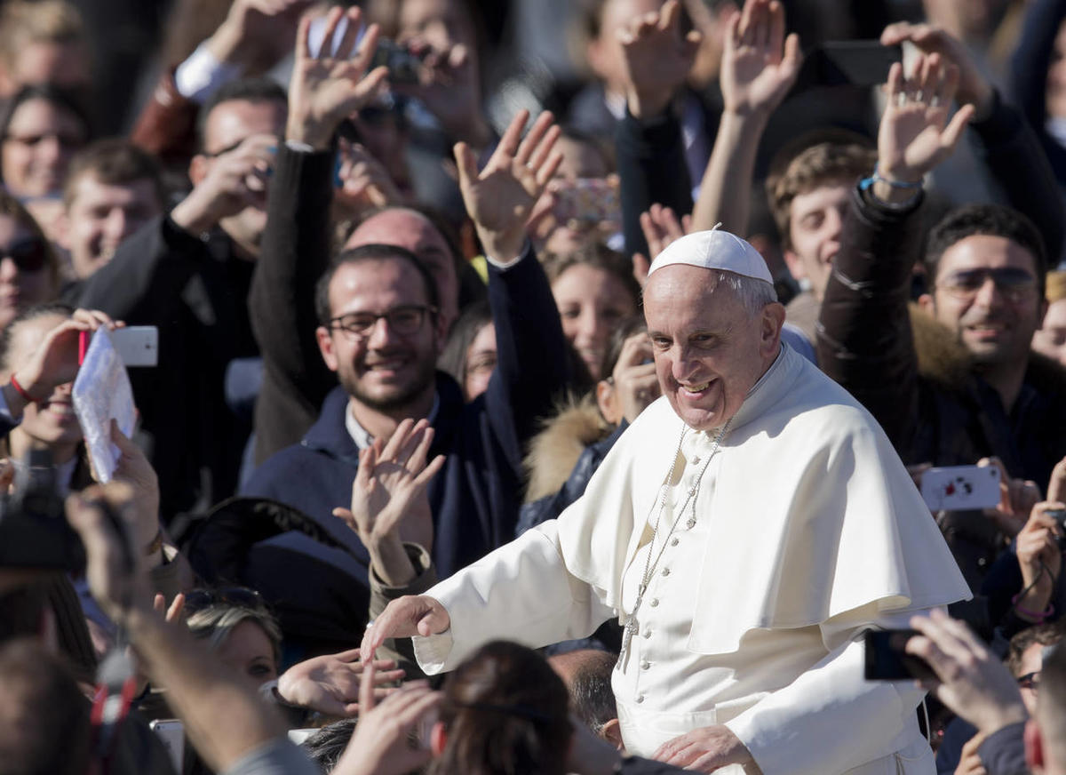 Pope Francis greets the crowd as he leaves  St. Peter's Square at the Vatican, Friday, Feb. 14, 2014. Pope Francis met a group of engaged couples on Valentine's Day and gave them advice for a successful marriage.