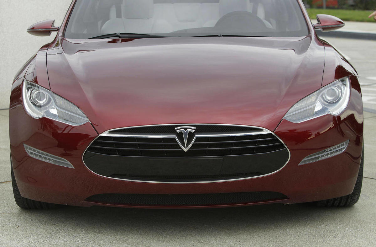 In this Oct. 27, 2010, file photo, the Tesla Model S electric sedan is shown during the unveiling of the new Tesla factory in Fremont, Calif.