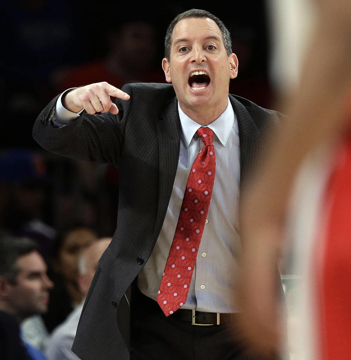 FILE - In this March 12, 2013, file photo, Rutgers coach Mike Rice yells out to his team during an NCAA college basketball game against DePaul at the Big East tournament in New York. The videotape, broadcast Tuesday, April 2, on ESPN, prompted scores of o