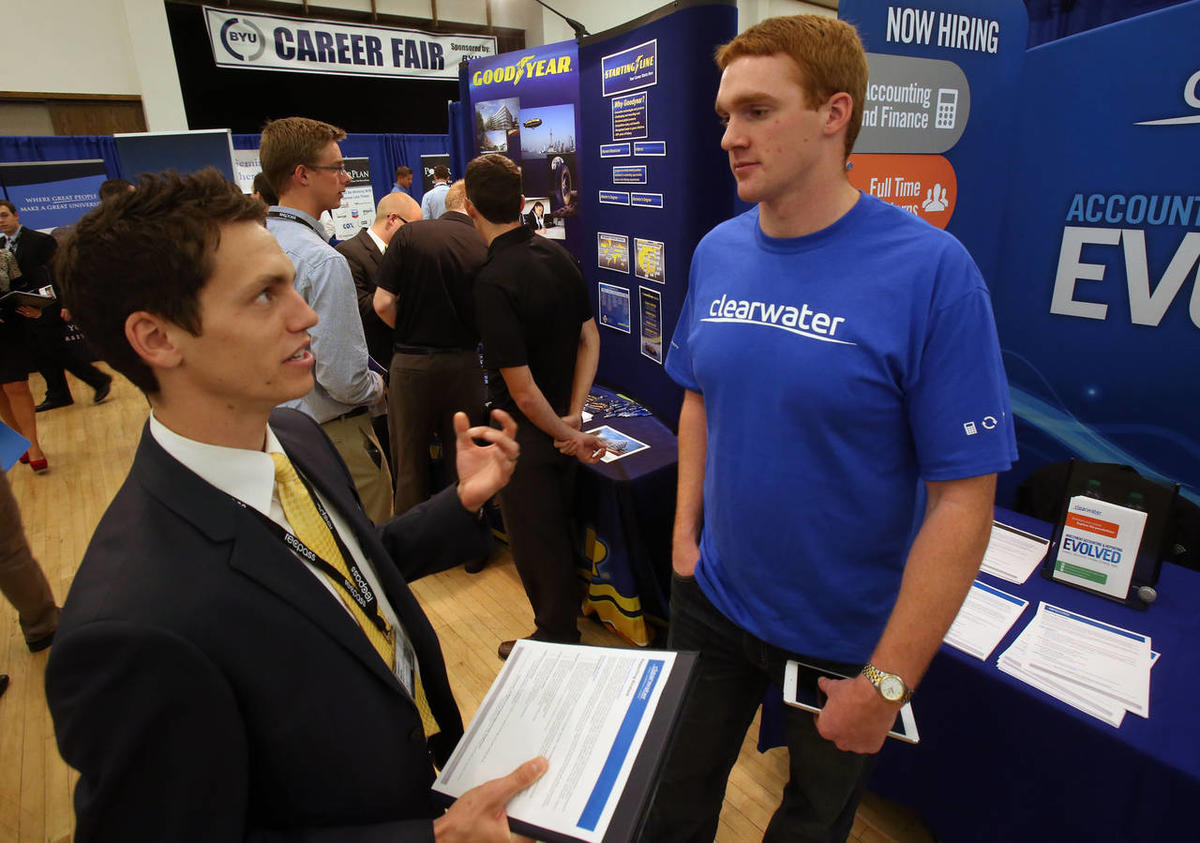 Preston Rutter talks with Ryan Gilkey, from Clearwater, at a job fair in the Wilkinson Center Ballroom at Brigham Young University in Provo on Thursday, Oct. 3, 2013.
