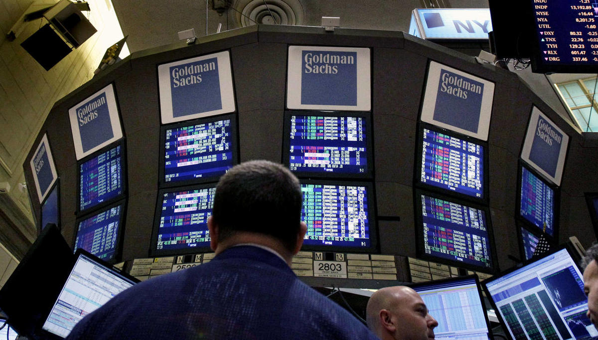 In this Thursday, March 15, 2012, file photo, traders work at the Goldman Sachs posts on the floor of the New York Stock Exchange. According to the McKinsey Global Institute, a research unit associated with the consulting firm McKinsey & Company, the Unit