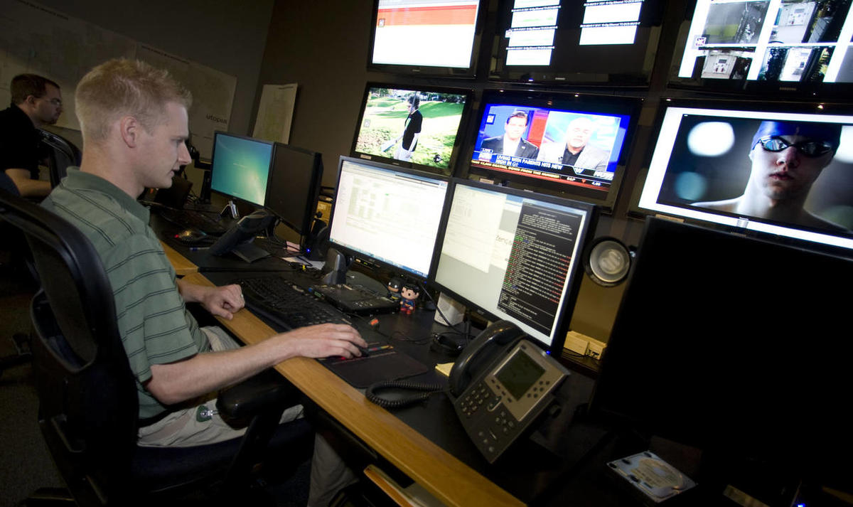 Technicians Josh Kester, front left, and Chris Adams, back left, work Wednesday, Aug. 1, 2012 in the Network Operations Center of Utopia.