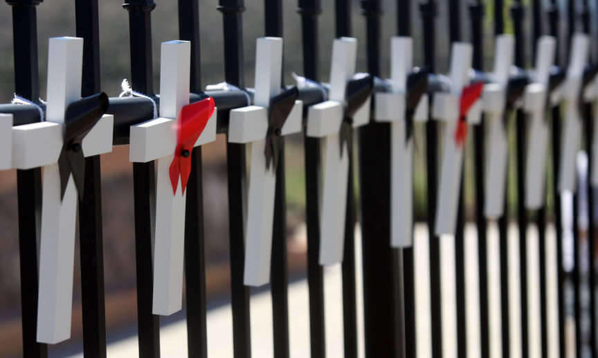 Crosses representing the victims of the Mountain Meadows Massacre are placed on the fence during an event marking the 150th anniversary of the Mountain Meadows Massacre at the memorial site Sept. 11, 2007. A new article on LDS.org provides context for thi